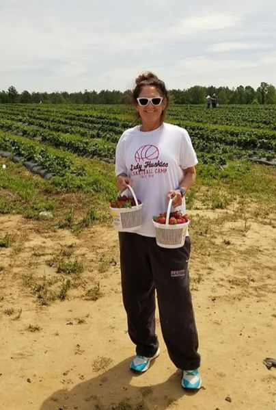 """Kathy Bowman said she and her husband """"had a lot of laughs and realized we have not been to the country in way too long' while picking strawberries in Clanton. (contributed)"""