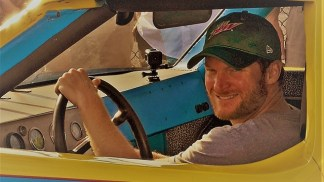 Dale Earnhardt Jr. poses in a car his father drove at the Talladega Superpeedway. (Michael Tomberlin / Alabama NewsCenter)