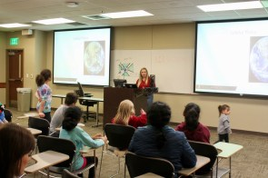 Piper Daniels, UASpace CubeSat program manager, speaks to students at the Night at the Museum event at the University of Alabama earlier this year. (contributed)