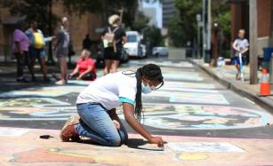 The street art in Mobile demonstrates the unity many are showing, both in the creation and in the message. (Mike Kittrell / Alabama News Center)