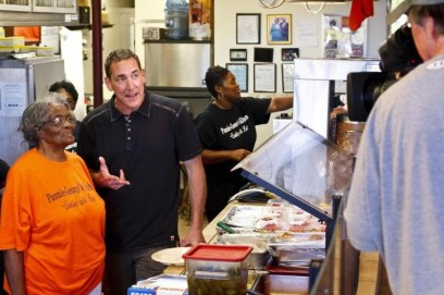 """Todd Blackledge with Pannie Taylor for his ESPN """"Taste of the Town"""" segment. (contributed)"""