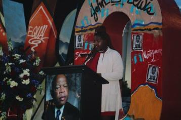 Troy University Khadidah Stone speaks at a memorial service honoring Troy native John Lewis. (contributed)