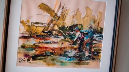 Emily McDaniel says this art was chosen because Rob enjoys fly fishing. (Dennis Washington / Alabama NewsCenter)