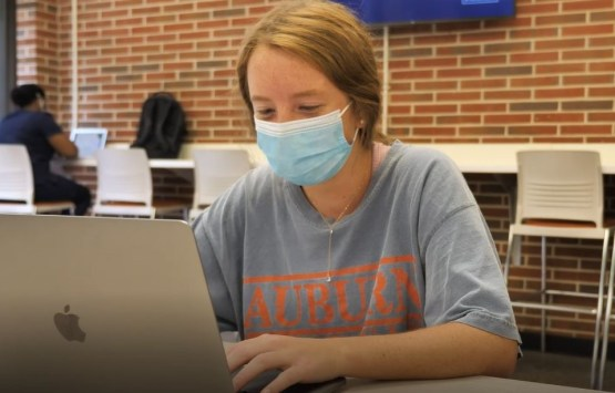A student works in the new Harold D. Melton Student Center at Auburn University. (Auburn University)