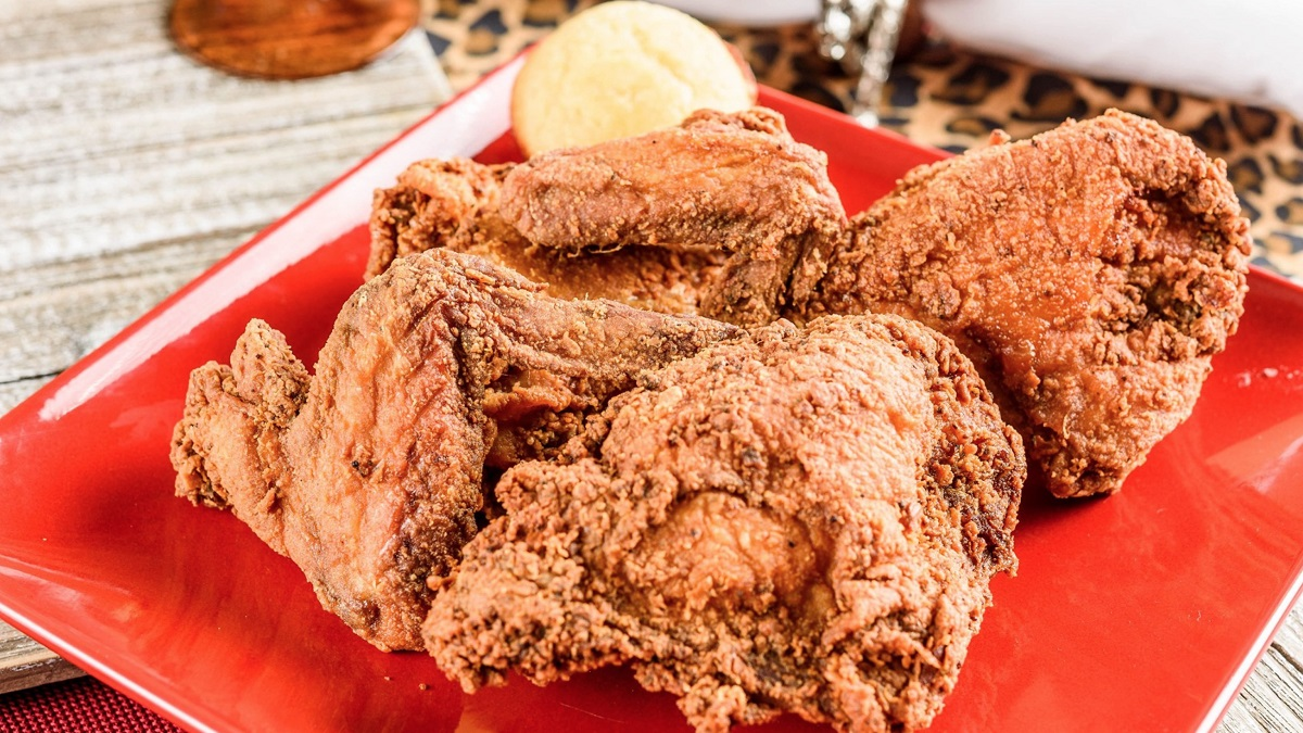 This fried chicken with black-eyed peas is one of 100 Dishes to Eat in Alabama