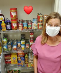 Lisa Brown, financial stability coach at Family Success Center, in the organization's new food closet. (contributed)