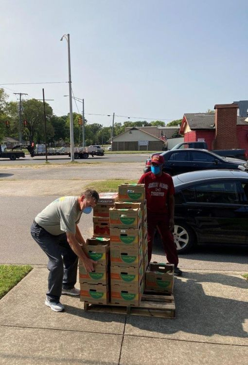 Copeland (left) enjoys helping his community. (Alabama Power Corporate Energizers)