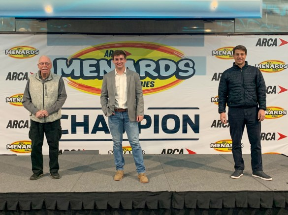 Bret Holmes (center) stands with NASCAR Hall of Fame driver Red Farmer (left) and Talladega Superspeedway President Brian Crichton after Tuesday's night ceremony. (contributed)