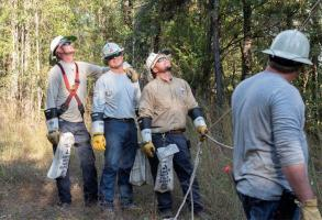 Alabama Power crews continued their often challenging work Sunday to restore service to those still without after the massive outages caused by Hurricane Zeta. (Wynter Byrd / Alabama NewsCenter)