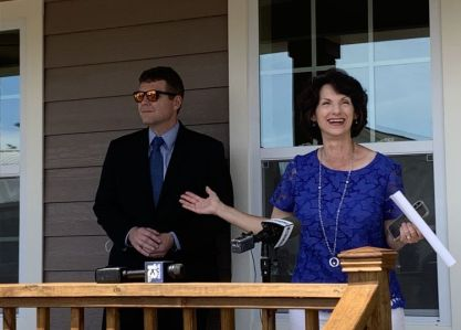Habitat Executive Director Potts, with Tuscaloosa Mayor Walt Maddox, was ecstatic to welcome the Wooleys to their new home. (Donna Cope / Alabama NewsCenter)