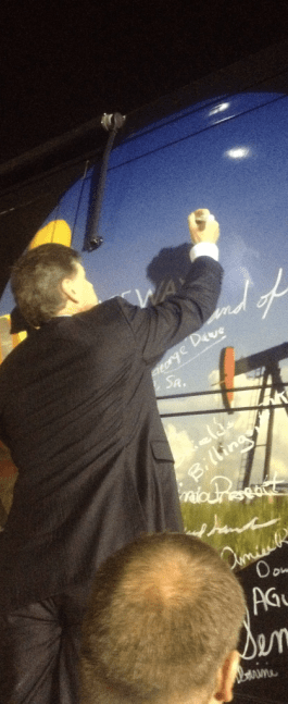 Sean Hannity signing Johnny Williams' bus