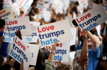 Delegates hold anti-Donald Trump signs during the Democratic National Convention in Philadelphia
