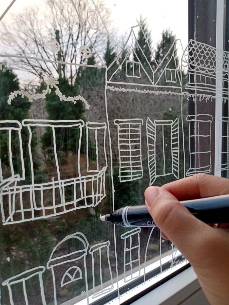 rysunki świąteczne na oknach