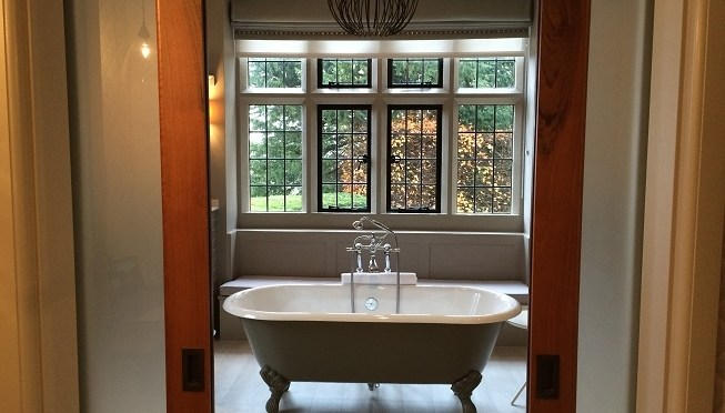 Baths in hotel bedrooms and transparent loo doors – treat or travesty?
