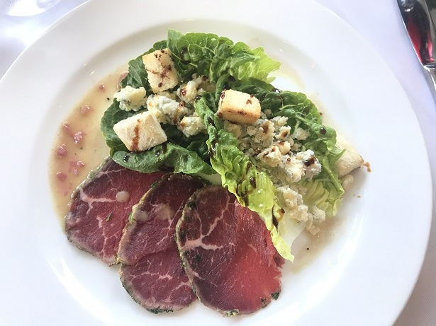 starter of beef carpaccio and stilton salad