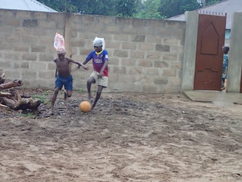 Village kids playing soccer