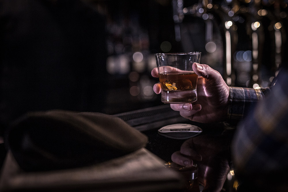 Whiskey Glass in hand - Commercial Photography