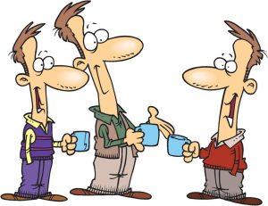 Three men talking and drinking coffee