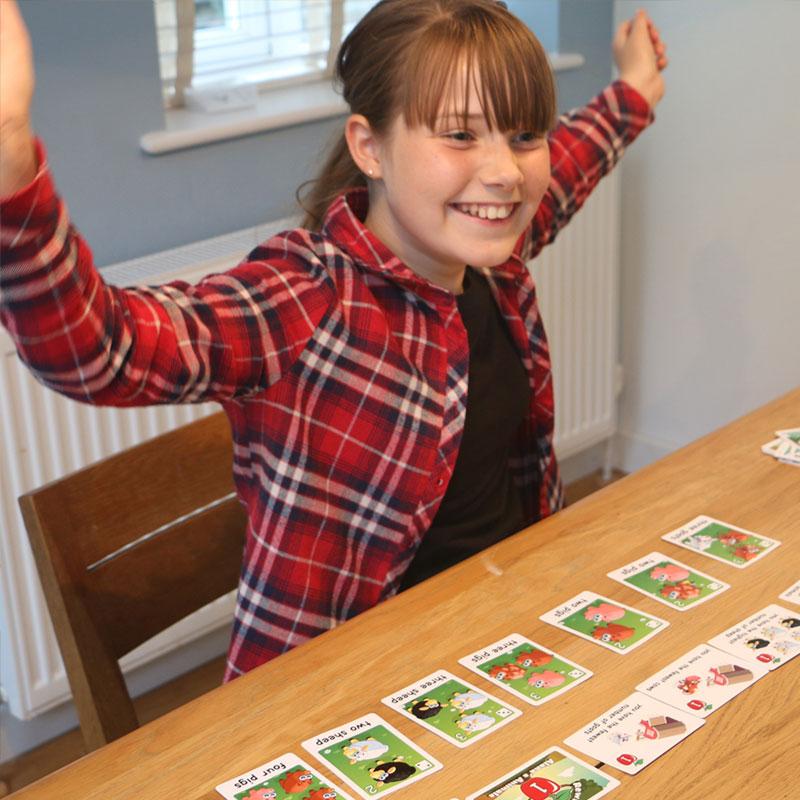Young girl playing Alana's Animals