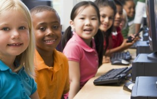 Young children at computer lab at school