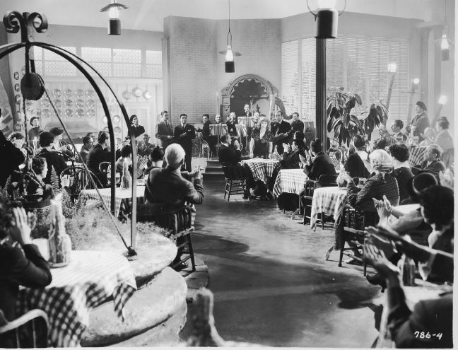 production still from movie Top of the Town interior cafe with orchestra featuring Alfonse Corelli