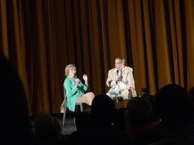 photo taken from audience of Nancy Olson on stage with Alan K. Rode