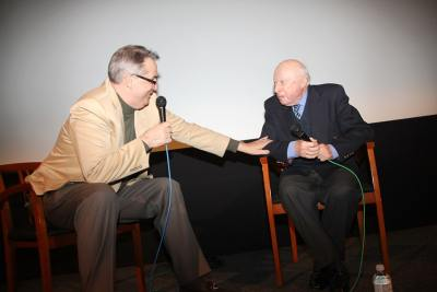 photo of Alan K. Rode on stage with 100 year-old Norman Lloyd