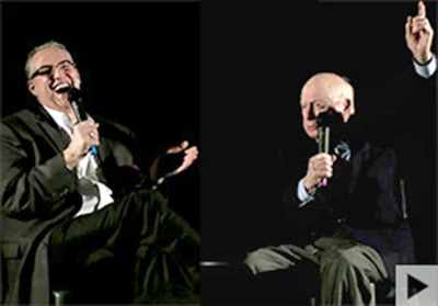 photo of Alan K. Rode seated next to Norman Lloyd as Norman tells a story
