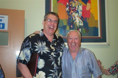 photo of Wally Cassell and Alan K. Rode sharing a laugh