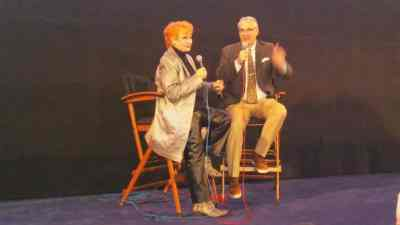 photo of Ann Robinson on stage being Interviewed by Alan K. Rode