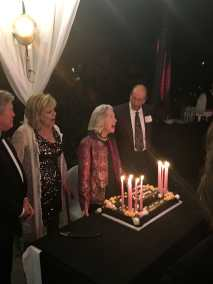 photo of Marsha Hunt ready to blow out candles on her 100th birthday celebration cake
