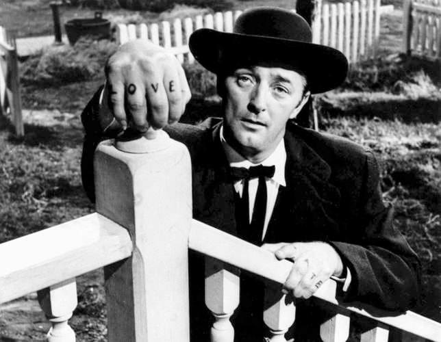 movie still from the night of the hunter showing robert mitchum with tatooed digits of right hand