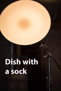 Here the Beauty Dish has a sock, or diffuser stretched over the opening, making the light softer.