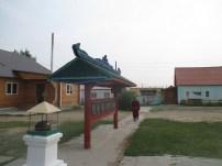 Monk and prayer wheels, Ivolginsky Datsan