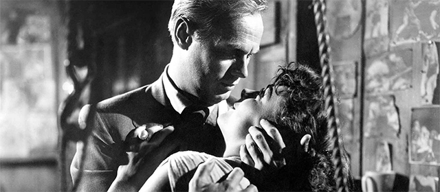 Richard Widmark et Jean Peters dans Le Port de la Drogue (1952)