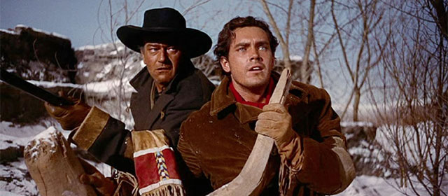 John Wayne et Jeffrey Hunter dans La Prisonnière du désert (1956)