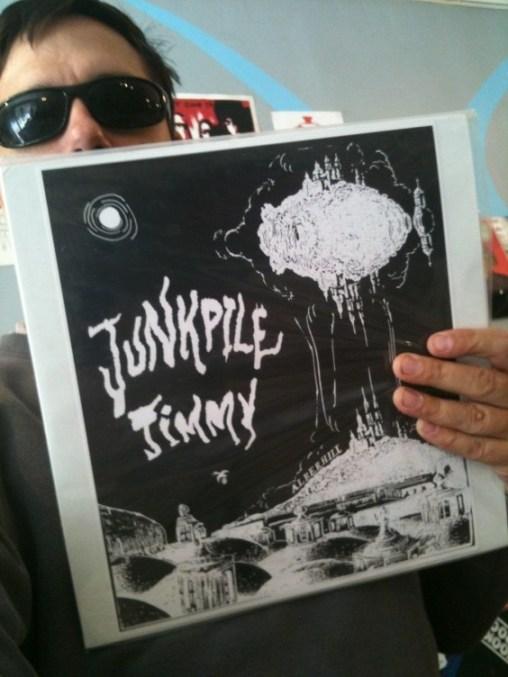 Goner Records co-owner Eric Friedl holds Junkpile Jimmy: Alberhill (self-released)