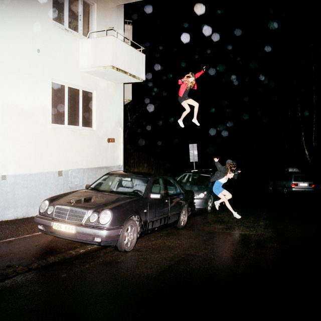 "Brand New's ""Science Fiction"" album art depicts two young women leap gracefully from a window into the street"