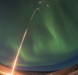 Time lapse photo of the NASA Oriole IV sounding rocket with Aural Spatial Structures Probe as an aurora dances over Alaska. All four stages of the rocket are visible in this image. Image Credit: NASA/Jamie Adkins