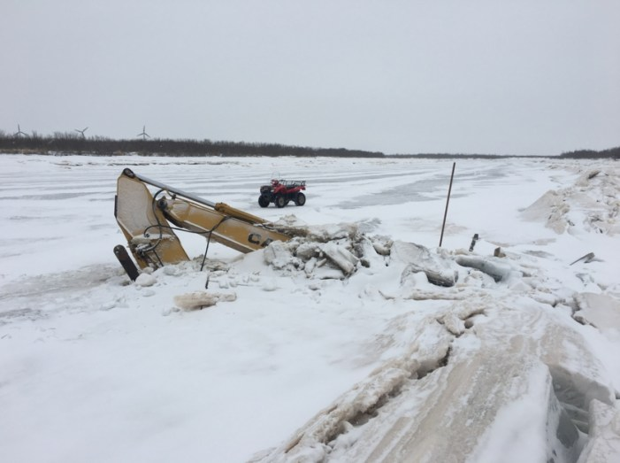 Excavator in Qinaq River Won't be Removed Until after Breakup