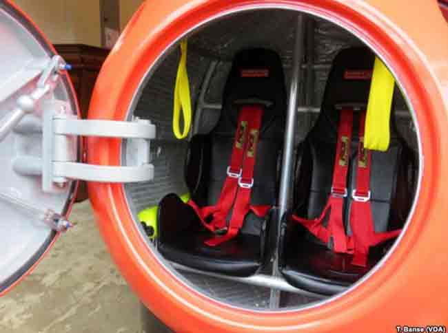 The capsule's seats have shoulder harnesses and seat belts to buckle in tight. Image-T. Banse/VOA
