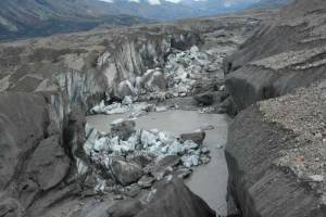A close-up view of the ice-walled canyon at the terminus of the Kaskawulsh Glacier, with recently collapsed ice blocks. This canyon now carries almost all meltwater from the toe of the glacier down the Kaskawulsh Valley and toward the Gulf of Alaska.Jim Best/University of Illinois
