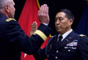 Alaska Army National Guard Col. Wayne Don, 38th Troop Command commander, pledges the Oath of Office, administered by Alaska Army National Guard Brig. Gen. Joseph Streff, Alaska Army National Guard commander, after Don promoted to full colonel.(U.S. Army photo by Sgt. David Bedard)