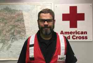 Shayne Jones, disaster program manager for the Red Cross of Alaska Serving the Far North and Interior, prepares to depart for Virginia, where he'll be on the ground pre-landfall to offer support and hope to those in the path of Hurricane Florence. Photo Credit: Cari Dighton/American Red Cross