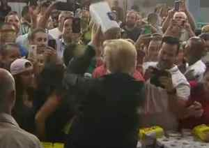 Trump throwing paper towel to Puerto Ricans in aftermath of deadly hurricane. Image-Guardian News video screenshot