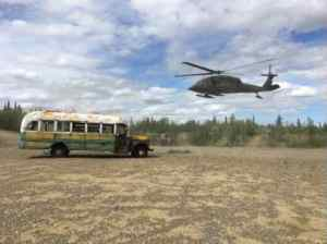 Photo courtesy of Alaska DNR Bus 142 is shown with a UH 60 Blackhawk helicopter that supported the Alaska Army National Guard operation that transported the bus from the Stampede Trail to an interim staging point on the Stampede Road.