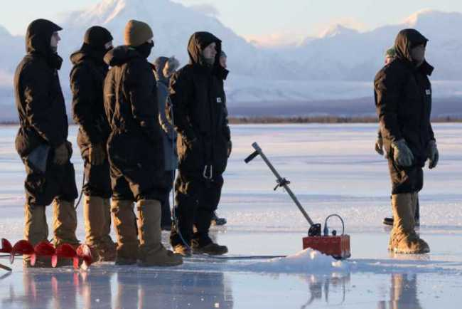 Paratroopers with 6th Brigade Engineer Battalion, 4th Infantry Brigade Combat Team (Airborne), 25th Infantry Division, use ground penetrating radar to check the thicknes of ice as they prepare to construct a bridge across the Tanana river at Donnelley Training Area, Alaska, Jan., 21, 2021. (U.S. Army photograph by Staff Sgt. Alex Skripnichuk)