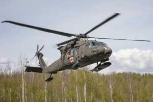 An HH-60M Black Hawk MEDEVAC helicopter from 1st Battalion, 207th Aviation Regiment, Alaska Army National Guard, lands at the Mat-Su Fire Training Site in Wasilla. (U.S. Army National Guard photo by Edward Eagerton)