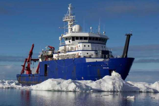 The research vessel Sikuliaq cruises through icebergs. The ship os owned by the National Science Foundation and operated by the University of Alaska-Fairbanks. Photo by Mark Teckenbrock.