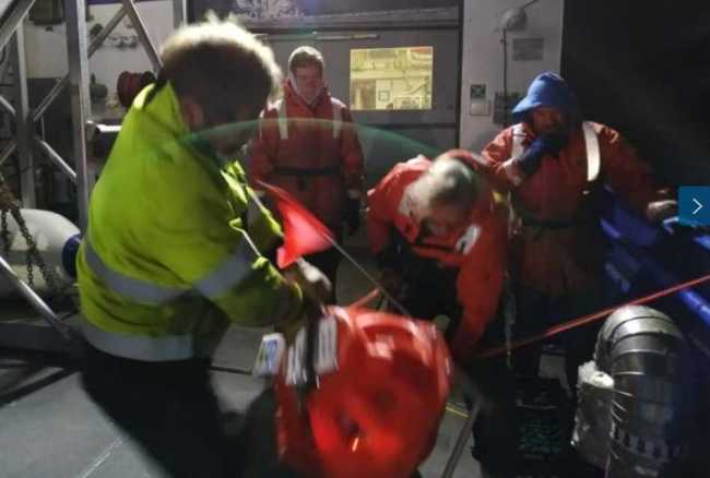 It takes more than an hour for an ocean bottom seismometer to rise from the seafloor to the surface. The device has a piese of nylon rope attached to it, which the crew grabs using a grappling hook. Image-Bernard Coakley.